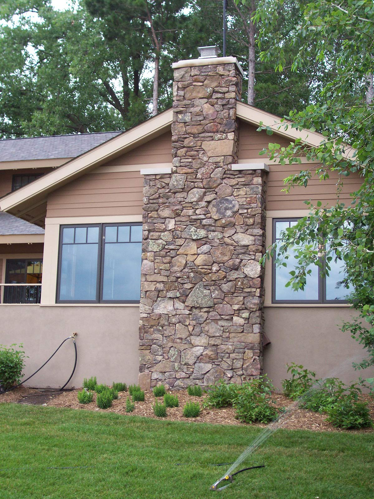 Minnesota roots landscape and contruction for Stone chimneys